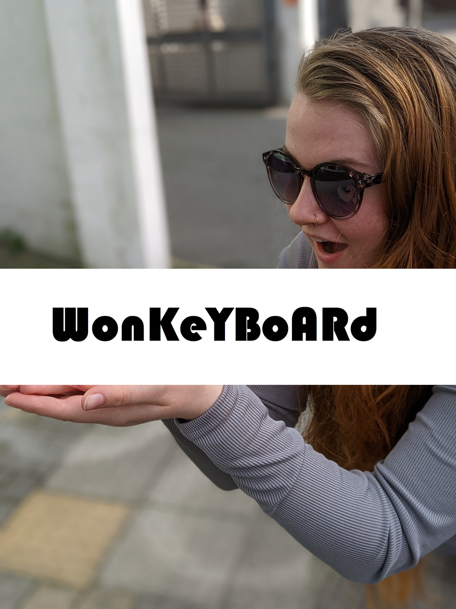 A model holding a wonkeyboard prototype, but witht the actual product obscured
